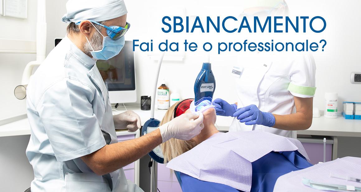 Il dottore Moreno Cangin che effettua uno sbiancamento dentale